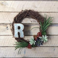 This modern succulents wreath is a great choice for your decor. Hues of green, purple, pink and red characterize this design. You can personalize it with a monogram, too. This wreath makes a great housewarming or wedding gift. It will bring warmth and style to any front door. - 18