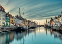 "by Jacob Surland.  About the photograph, Jacob Surland says: ""In the heart of Copenhagen in Denmark lies Nyhavn (New Port). It used to be a port for trading goods, but now it's a place, that the people of Copenhagen gather for a cold beer or a homemade Ice cream during the summer. The canal tours also have their starting point here."""