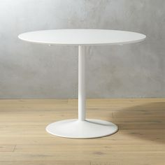 Shop odyssey white tulip dining table.   A high styling, hardworking table for all your spaces: dining, kitchen, living, office.