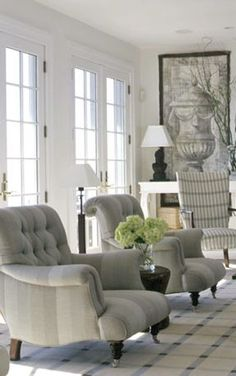 We love the oversized tufted chairs in this new traditional style living room
