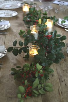 Decorate with Holly and Tea Lights for an easy Christmas table centerpiece.