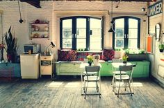 A fresh, wooden, rustic, textures, pastel, open floor plan.  I actually like the painted brick.  I usually don't.