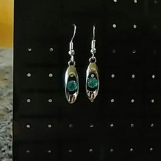 New silver plated water drop crystal dangle earrin New silver plated water drop crystal dangle earrings, blue stones in the middle. Never been worn. Jewelry Earrings