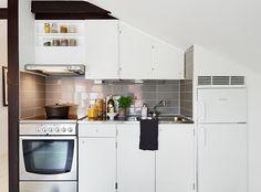 CUTE compact kitchen in a 34 Square Meter Cozy Attic Studio Apartment  11
