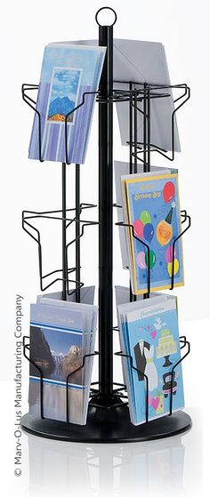 """Countertop merchandiser for standard size 5""""W x 7.75""""H greeting cards 12 card pockets, each 1.5"""" deep, hold up to 12 dozen cards vertically Bottoms of pockets slanted for best viewing angle - enables gravity feeding of cards Overall Dimensions: 29"""" high; 12"""" spinning diameter All pockets are 5-9/16""""W x 8-3/4""""H with a depth of 1-1/2"""" Durable black powder-coat finish Need more than 100. Please contact us for bulk discount."""