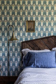 Voysey wallpaper with indigo linen pillow and John Robshaw duvet cover. By Jersey Ice Cream Co.