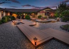 Backyard With Gravel Landscaping and Staggered Deck Walkway