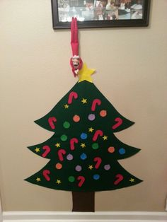 Felt tree. Kids loved decorating and redecorating their felt tree.