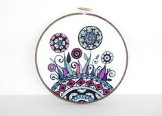 Embroidery Hoop Art, Abstract Flowers and Swirls Inspired by Mehndi in Warm Colors. Flower Garden 7 inch Hoop Wall Art by SometimesISwirl. $245.00, via Etsy.