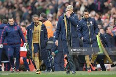 Arsenal's French manager Arsene Wenger (2R) leads off his team at the end of the English Premier League football match between Manchester United and Arsenal at Old Trafford in Manchester in north west England on February 28, 2016. / AFP / OLI SCARFF / RESTRICTED TO EDITORIAL USE. No use with unauthorized audio, video, data, fixture lists, club/league logos or 'live' services. Online in-match use limited to 75 images, no video emulation. No use in betting, games or single club/league/player…