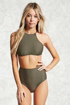 A pair of stretch-knit bikini bottoms featuring a high-waist fit and an elasticized waist. Matching bikini top available.