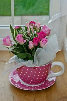 pretty pink roses in a pink polka dot cup
