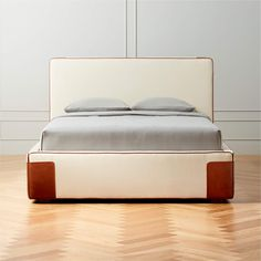 Starting her career in the NYC fashion industry, designer Sasha Adler's fully upholstered bed clearly draws from her editorial background. Covered all the way around in a textural ivory linen, bed is trimmed with genuine leather piping and leather-wrapped corners. Mattress will sink into the frame slightly, making it easy to tuck bedding in and keep things tidy. CB2 exclusive. Leather Daybed, Black Leather Chair, Plywood Headboard, Headboard And Footboard, Outdoor Loveseat, Outdoor Rocking Chairs, New Furniture, Bedroom Furniture, Queen Beds