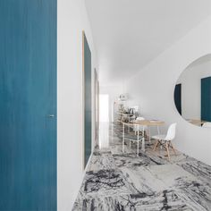 Porto architecture studio Fala Atelier has overhauled a fragmented 19th-century Lisbon flat, creating a long narrow living area framed by a subtly curved wall