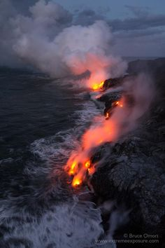 Synthesis - A longer exposure softens the movement of waves, lava, and billowing steam at the Kupapa'u ocean entry in Kalapana, Island of Hawai'i. The dynamicity of volcanic activity is mesmerizing, as no two frames are ever identical. All Nature, Amazing Nature, Nature Images, Best Hawaiian Island, Lava Flow, Hawaii Travel, Land Scape, Beautiful Places, National Parks