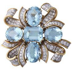 TIFFANY & CO. SHLUMBERGER Diamond, Gold, and Aquamarine Brooch. Circa 1959.