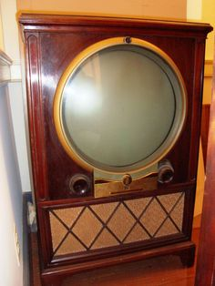 "Zenith black-and-white television set, The round viewing screen is 16 inches in diameter. The cabinet (or ""chassis"") is mahogany veneer. Radios, Vintage Tv, Vintage Antiques, Vintage Items, Vintage Black, Tvs, Illuminati, Radio Antigua, Television Set"