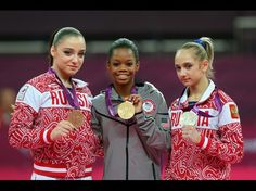 Bronze medalist Aliya Mustafina of Russia, gold medalist Gabrielle Douglas of the United States and silver medalist Victoria Komova of Russia pose
