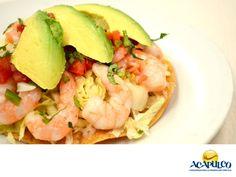 #gastronomiaguerrerense Las mejores tostadas de camarón. LAS MEJORES RECETAS. Las mejores tostadas de camarón,las puedes encontrar en el puerto de Acapulco. Se preparan con ingredientes frescos y con una sazón que no hay en otro lugar. Disfrutarlas admirando el increíble paisaje del Puerto, las hace un deleite inolvidable. No dejes de probarlas, durante tus próximas vacaciones en Acapulco. www.fidetur.guerrero.gob.mx