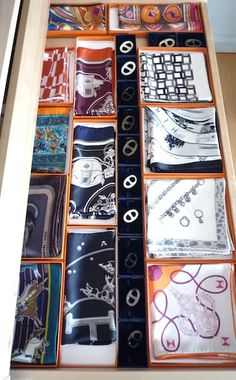 Transform spare bedroom into closet -- drawer organization for silk scarves.