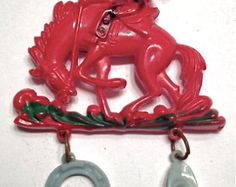 Vintage Red Celluloid Dangle Cowboy Brooch