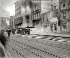 """May 18, 1913. Washington, D.C. """"U.S. Geological Survey fire, F Street N.W."""" The blaze was largely confined to the basement."""