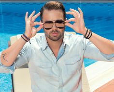 Ilias Vrettos is posing wearing KΛRKΛLIS jewelry! Ray Bans, Greek, Mens Sunglasses, Poses, How To Wear, Jewelry, Style, Fashion, Figure Poses