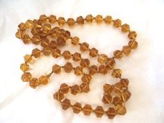 This necklace is just gorgeous! Faceted cut glass beads are individually tied. I suspect this is from the 1930s. RetroRosiesVintage on Etsy.