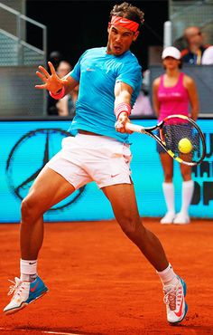 Rafael Nadal strikes a forehand in his 6-4 6-3 Second Round victory over Steve Johnson during the 2015 Mutua Madrid Open. The two-time defending champion, Nadal eventually made it to the Final where he fell 6-3 6-2 to Andy Murray.