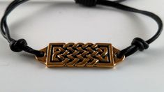 "Adjustable 1/5 mm Black Leather Bracelet    Antique Gold Celtic Bar (1-1/2"") 