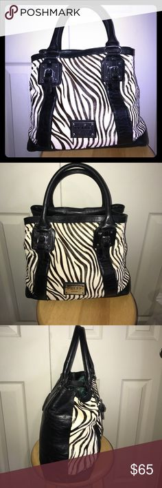 Gorgeous PELLE leather and Ponyhair Zebra bag This is a terrific huge bag! Made of soft calf leather and Ponyhair .. very clean inside and out . There a a few minor balding spots of the Ponyhair but not very noticeable. Bag is in beautiful condition ! Pelle Studio Bags Totes