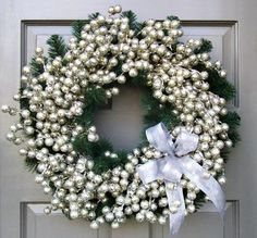 Wreath with clusters of silver berries on an evergreen wreath base. 22 diameter x 9 deep