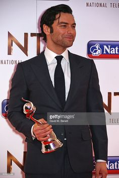 Aidan Turner, winner of the Impact Award, attends the 21st National Television Awards at The O2 Arena on January 20, 2016 in London, England.