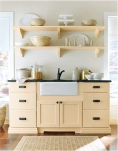 Leaning more and more toward Martha Stewart cabinets is this design (trim on doors but not drawers) in Sharkey Gray.  Icebox latches for hardware.  Mixed reviews on quality and I HATE Home Depot, but the look....hmmm