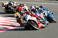 BSB. 2012 Eldest of the Poverty racing brothers, John Laverty (Eugene in WSB, Michael in MotoGP) leads the second group including brother Michael on the Samsung Honda, Alex Lowes, WFR Honda,  *dunno*, Stuart East on, Rapid Solicitors Kawasaki, Tommy Bridewell, Supersonic BMW.