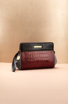 ESCADA clutch in a mix of materials and colors: python and croc