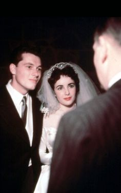 """Always a Bride, Never a Bridesmaid: An extremely rare color photograph of Elizabeth Taylor's first wedding, and the first of many I do's, this time to hotel heir Conrad """"Nicky"""" Hilton. The Bride was 18."""