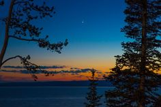 Venus and Jupiter over Yellowstone Lake in Yellowstone National Park, Wyoming, on June 30, from Jack Webb.
