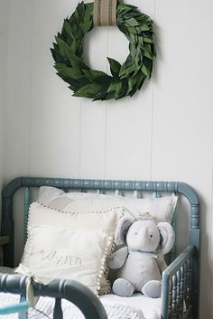 Christmas wreath above kids bed