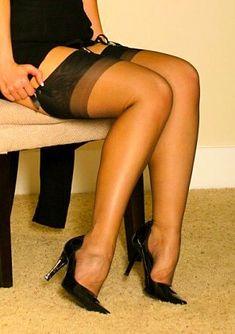 Black stockings with black heels.