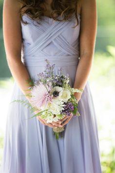 Soft purple wedding bouquet and lavender bridesmaid dress