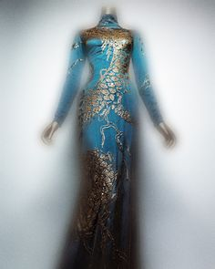 Alexander McQueen (British, 1969–2010). Dress, autumn/winter 2006–7. Blue-green silk charmeuse embroidered with copper sequins and clear crystals, overlaid with copper silk mesh. Courtesy of Alexander McQueen | Photography © Platon #ChinaLookingGlass #AsianArt100