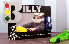 Speed into a fun after school craft with this new Race Car Frame idea! This project is easily customizable for any name and will look awesome in your kid's room! Frame Crafts, Diy Frame, Large Wood Letters, Silver Metallic Paint, Painted Closet, Ladybug Garden, Easy Thanksgiving Crafts, Craft Projects For Kids, Craft Ideas