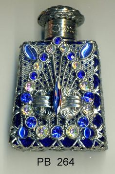 Hey, I found this really awesome Etsy listing at https://www.etsy.com/ie/listing/251231004/glass-perfume-bottle-dark-blue-bottle