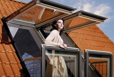 So clever - a normal attic window but the bottom opens out into a balcony