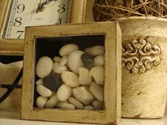 bathroom decor. what you need: small wooden box,spray paint, white stones..for a rustic look just scrub over dry paint with a knife or so..#diy