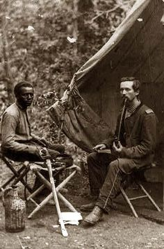 Black Soldier in the Civil War - Here for your enjoyment is an inspiring photograph of 23rd New York Infantry. It was made between 1861 and 1865.  The photo illustrates Two soldiers, one black and one white smoking a long pipe in front of tent.
