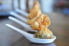 Delicious filling of ricotta, cream cheese, and spinach in a crispy wonton wrapper.