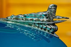 1950 Woodie Wagon One of a Kind Hood Ornament. A one of a kind custom hood ornament that seems to be a totem pole surfing… on a 1950 Ford Woodie Wagon. Custom Hood Ornaments, Car Hood Ornaments, Car Badges, Car Logos, Vintage Cars, Antique Cars, Car Bonnet, Car Head, Radiator Cap