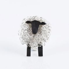 "This 'Sheep Brooch' by Avril Manderson is the Craft NI Object of the week, selected by Orla McGrady.  She says: ""Perfect for this time of year when the fields are in abundance with new lambs! Silversmith Avril's quirky, fun sheep in fine sliver wire and sterling silver never fail to make me smile.""  Image by Simon Mills Photography. More information - http://www.craftni.org/products/sheep-brooch"